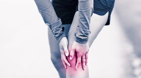 Runners knee leg pain, woman holding sore and overtrained painful knee, sprain or cramp ache filled with red pink bright place. Overtraining injured person when exercising or running outdoors.