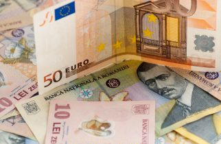 76459788 - romanian leu currency bills and fifty euro bill concept photo