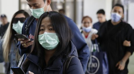 Passengers wear masks as they arrive at Manila's international airport in the Philippines on Thursday. The government is closely monitoring arriving passengers as a new coronavirus outbreak in Wuhan, China, has infected hundreds.
